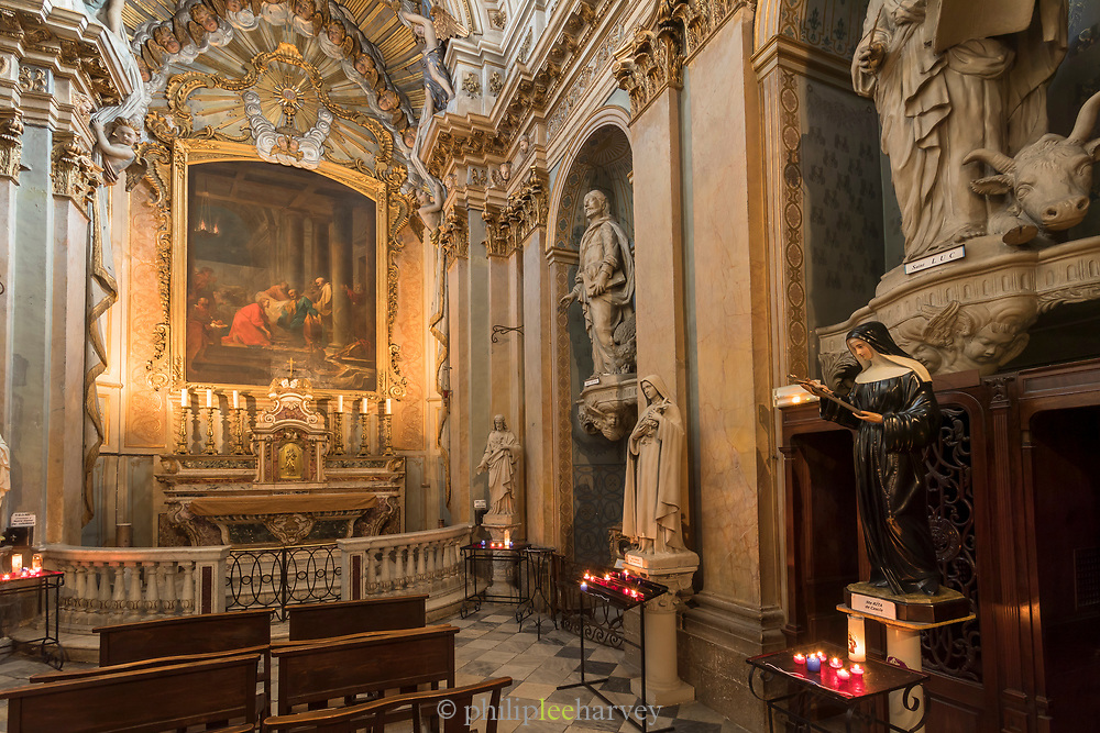 Interior of Grasse Cathedral altar with painting, host, statues and candles, Notre-Dame-du-Puy de Grasse, Grasse, France
