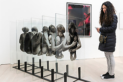 """© Licensed to London News Pictures. 17/05/2019. LONDON, UK. A woman views """"Exhibit"""", 2015, by Lenny Rébéré at the Draw Art Fair London, the first fair in the UK dedicated to modern and contemporary drawing.  58 international galleries have juxtaposed drawings with related paintings, sculptures, photos or videos, in a ratio of approximately 70% to 30%, using drawing as the core concept.  The inaugural show is open to the public 17 to 19 May 2019 at the Saatchi Gallery in Chelsea.  Photo credit: Stephen Chung/LNP"""