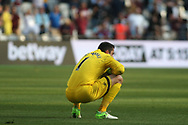 Lukasz Fabianski of Swansea City is dejected at full time.  Premier league match, West Ham Utd v Swansea city at the London Stadium, Queen Elizabeth Olympic Park in London on Saturday 8th April 2017.<br /> pic by Steffan Bowen, Andrew Orchard sports photography.