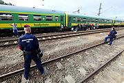 Migrants at Bicske train station, Hungary in a tense stand-off between police and migrants which continues into a second day. On Thursday, police let the migrants board the train in Budapest but then tried to force them off at a refugee camp to the west of the capital.