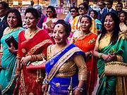 13 MARCH 2017 - PATAN, NEPAL: Hindu women participate in a wedding procession near Patan's Durbar Square.     PHOTO BY JACK KURTZ
