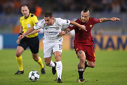 Roma's Radja Nainggolan and Chelsea's Eden Hazard battle for the ball