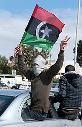 © under license to London News Pictures. 24/02/2011. A man shows his support for the Opposition as he rides in a car through the Libyan city of Benghazi. Photo credit should read Michael Graae/London News Pictures