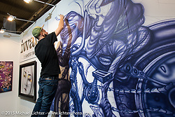 Airbrush demo at EICMA, the largest international motorcycle exhibition in the world. Milan, Italy. November 18, 2015.  Photography ©2015 Michael Lichter.
