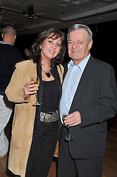 TONY BLACKBURN and his wife DEBRA at the 5th annual West End Eurovision in aid of the make A Difference Trust held at The Dominion Theatre, London on 26th April 2012.