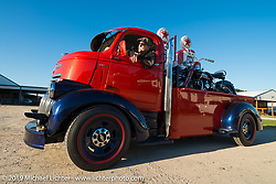 """If you have to Haul your bike - do it in style! """"Tink"""" Allan Bell of Vestal, NY in his very custom 1946 cabover with an antique Harley in the box at the AMCA Swap Meet in New Smyrna Beach, FL during Daytona Bike Week, FL., USA. March 8, 2014.  Photography ©2014 Michael Lichter"""