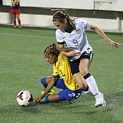 Brazil defender Rilany (2) and U.S. midfielder Heather O'Reilly (9) chase the ball during a women's soccer International friendly match between Brazil and the United States National Team, at the Florida Citrus Bowl  on Sunday, November 10, 2013 in Orlando, Florida. The U.S won the game by a score of 4-1.  (AP Photo/Alex Menendez)