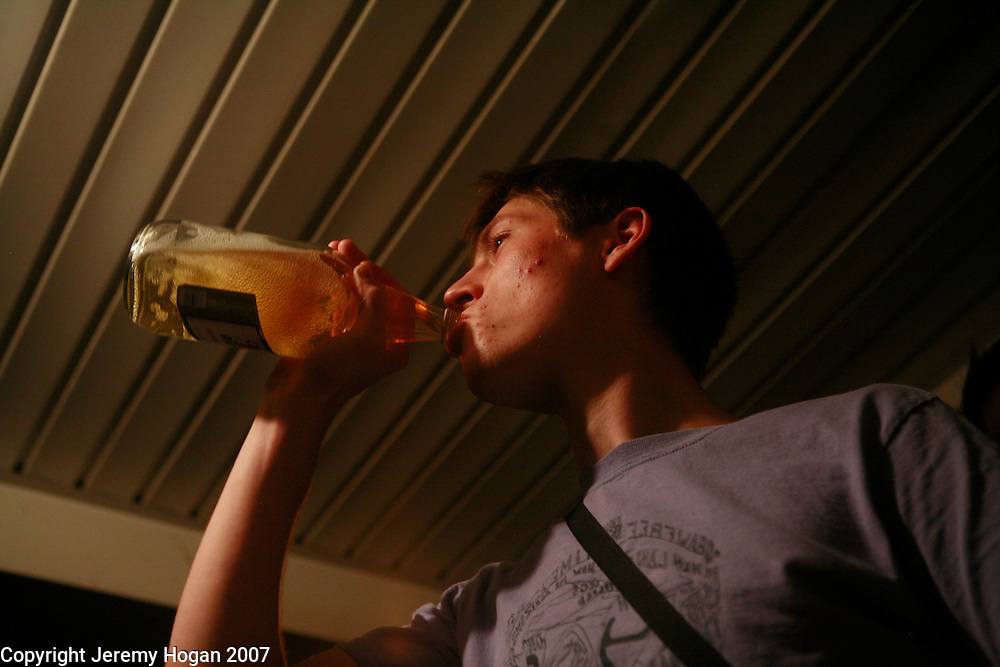 Justin Rhody drinks from a 40 ounce beer bottle during a punk show.