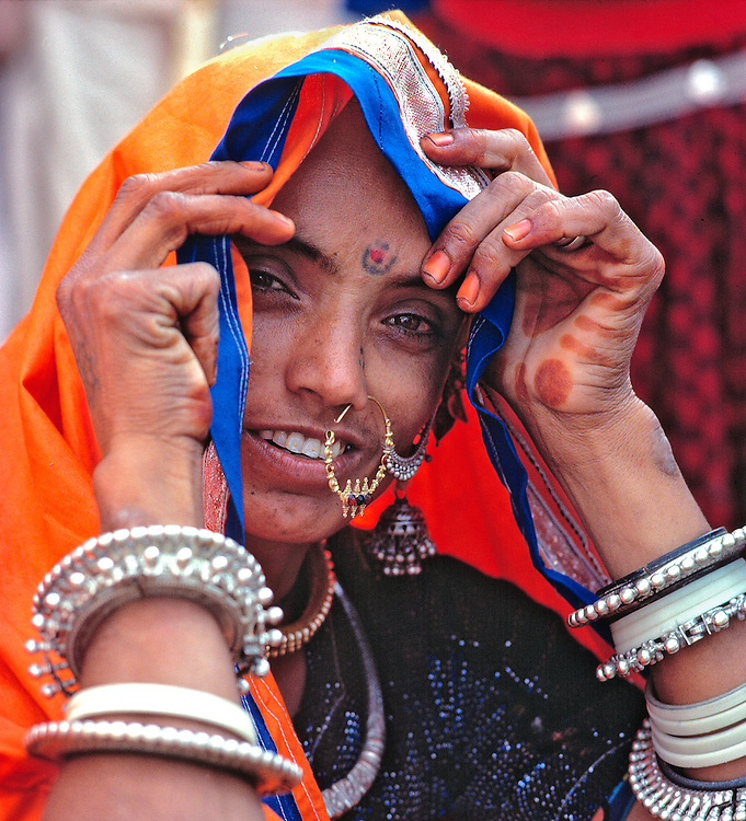 A jewelry vendor displays her wears at the market at Pushkar, Rajasthan, India.