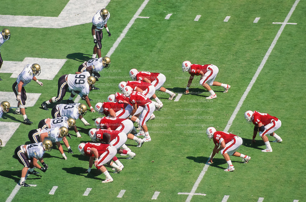 COLLEGE FOOTBALL:  Stanford vs Colorado on September 28, 1991 at Stanford Stadium in Palo Alto, California.  Visible Stanford players include Jason Palumbis #12, Ryan Wetnight #86, Bob Whitfield #70, Gllyn Milburn #5, Brian Cassidy #65, Tommy Vardell #44.  Photograph by David Madison | www.davidmadison.com