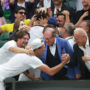LONDON, ENGLAND - JULY 15: Lucasz Kubot of Poland and Brazil's Marcelo Melo celebrate with their family and supporters after winning the Men's Doubles Final on Center Court during the Wimbledon Lawn Tennis Championships at the All England Lawn Tennis and Croquet Club at Wimbledon on July 15, 2017 in London, England. (Photo by Tim Clayton/Corbis via Getty Images)
