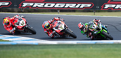 February 25, 2018 - Melbourne, Victoria, Australia - British rider Jonathan Rea (#1) of Kawasaki Racing Team leads British rider Chaz Davies (#7) of Aruba.it Racing - Ducati and Spanish rider Xavi Fores (#12) of Barni Racing during the second race on day 3 of the opening round of the 2018 World Superbike season at the Phillip Island circuit in Phillip Island, Australia. (Credit Image: © Theo Karanikos via ZUMA Wire)