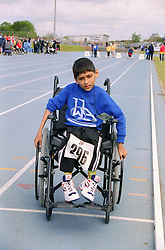 Young boy with disability taking part in Mini games sports event held at Stoke Mandeville Stadium,