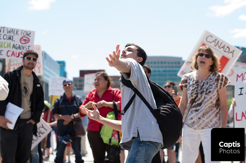 People dance on Parliament Hill during a protest against Monsanto. May 31, 2014.