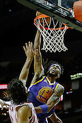 April 21, 2012; Houston, TX, USA; Houston Rockets power forward Luis Scola (4) fouls Golden State Warriors center Mikki Moore (31) during a dunk attempt during the third quarter at the Toyota Center. Mandatory Credit: Thomas Campbell-US PRESSWIRE