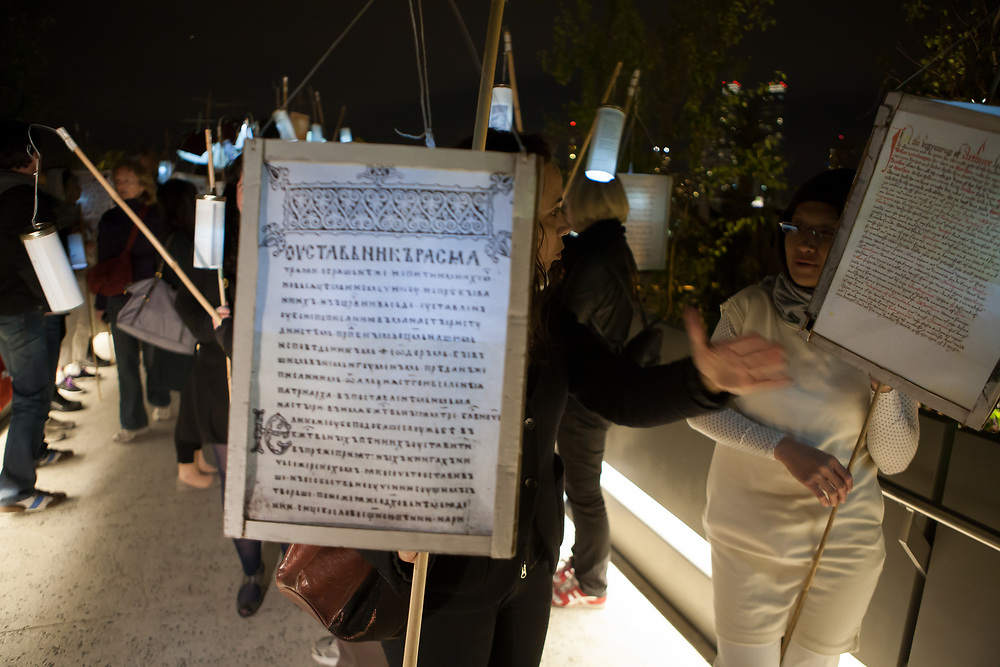 New York, NY - 30 April 2012. Marchers carrying back-lit texts in several languages preparre for the start. Participants in this year's festival came from Asia, Africa, Europe as well as the Americas.