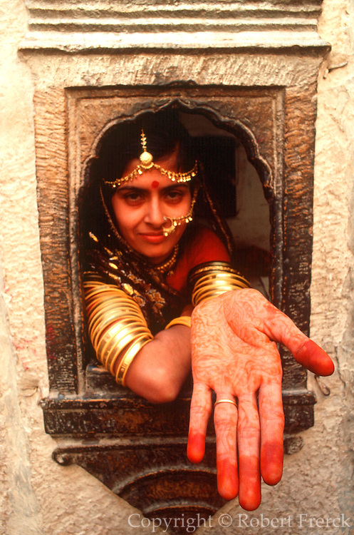 INDIA, PORTRAITS Traditional pattern or 'mehndi'; a decorative design applied to the  palm of the hand for ceremony