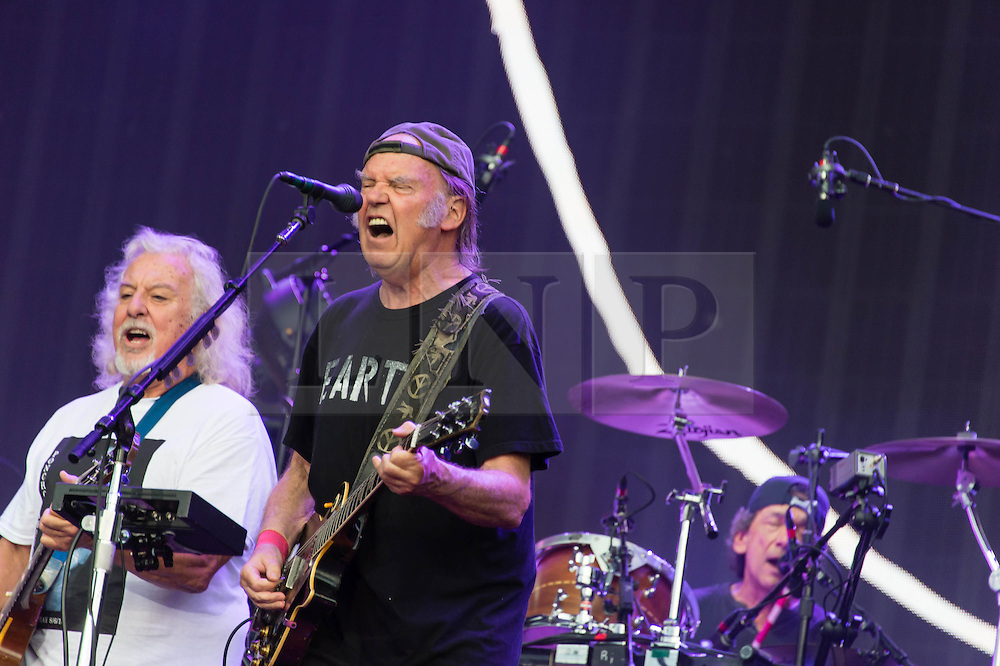 "© Licensed to London News Pictures. 12/07/2014. London, UK.   Neil Young and Crazy Horse performing live at Hyde Park as part of the British Summer Time series of outdoor concerts.In this picture - Neil Young (centre), Frank Sampredo (left), Ralph Molina (right).   Crazy Horse is a rock band long associated with Neil Young,  consisting of members Rick Roses, (bass, vocals), Ralph Molina (drums, vocals), Frank ""Poncho"" Sampedro ( guitar, organ, keyboards).  Photo credit : Richard Isaac/LNP"