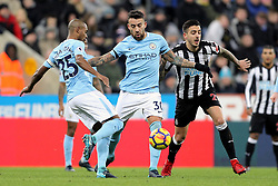 Manchester City's Fernandinho (left) and Nicolas Otamendi (centre) battle for the ball with Newcastle United's Mato Joselu (right) during the Premier League match at St James' Park, Newcastle.