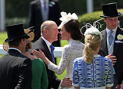Mike Tindall greets Kate, the Duchess of Cambridge, during day one of Royal Ascot at Ascot Racecourse.