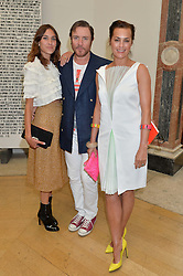 Left to right, ALEXA CHUNG and SIMON & YASMIN LE BON at the annual Royal Academy of Art Summer Party held at Burlington House, Piccadilly, London on 4th June 2014.