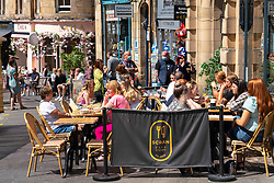 Edinburgh, Scotland, UK. 1 July  2021. Warm temperatures and sunshine attracted many members of the public to Edinburgh's outdoor cafes and bars and to the new St James Quarter shopping mall which opened last week. Pic; Outdoor cafes and bars, such as Scran, on Cockburn Street were busy. Iain Masterton/Alamy Live News