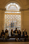 Visitors to Tate Britain sit in front of a newly commissioned window in London, England, United Kingdom. Tate Britain is the national gallery of British art. Located in London, it is one of the family of four Tate galleries which display selections from the Tate Collection. Tate Britain is the world centre for the understanding and enjoyment of British art and works actively to promote interest in British art internationally.