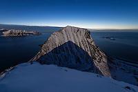 Moon shadow on Veggen mountain peak from Mannen, Vestvågøy, Lofoten Islands, Norway