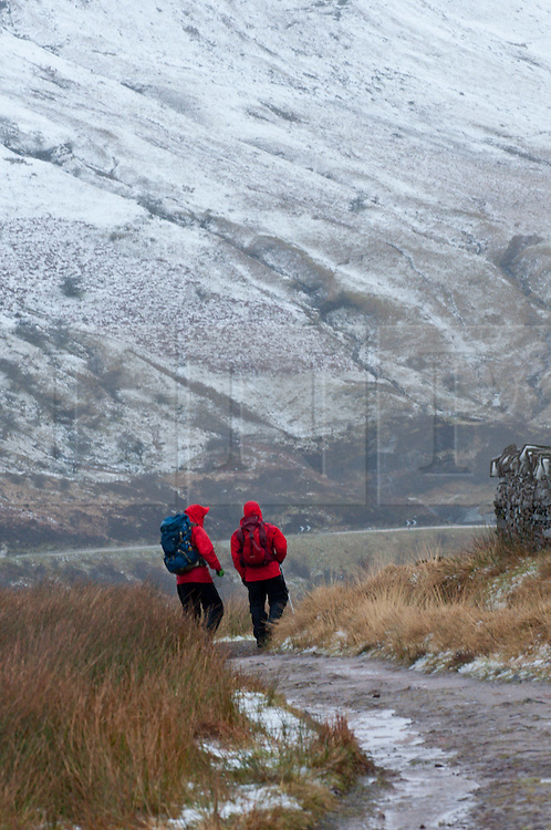 © Licensed to London News Pictures. 14/02/2014. Storey Arms, Brecon Beacons, Powys, Wales, UK. Steve Hamer 50 from Camberley and Charlie Pert  55 from Heathrow,down in Wales for two days holiday tried to climb Pen-Y-Fan, the highest summit of the Beacons but conditions were too horrendous and only made halfway. Snow, driving hail and storm force winds hit the Brecon Beacons. Photo credit : Graham M. Lawrence/LNP