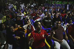 June 19, 2018 - Cairo, Egypt - Egyptian soccer fans react as they watch the FIFA World Cup 2018 group A preliminary round soccer match between Egypt and Russia in downtown Cairo, Egypt, on 19 June 2018. (Credit Image: © Ibrahim Ezzat/NurPhoto via ZUMA Press)