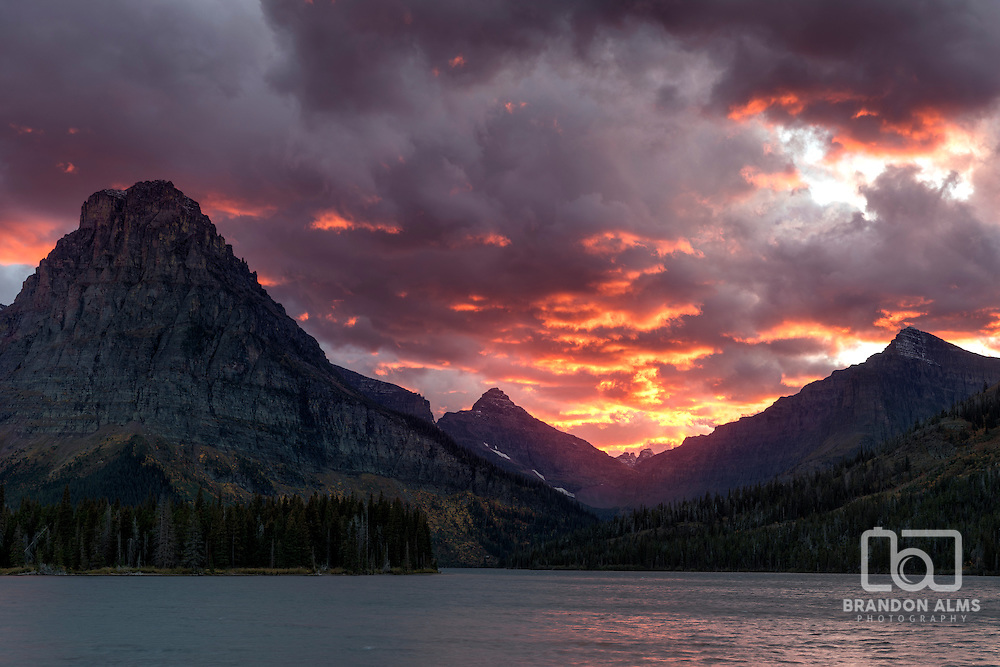 After a cold, windy, and rainy day, a beautiful sunset forms at Two Medicine Lake in Glacier National Park, Montana.