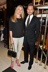 SEB & HEIDI BISHOP at a dinner in honour of Christy Turlington hosted by Porter magazine at Mr Chow, Knightsbridge, London on 18th November 2014.