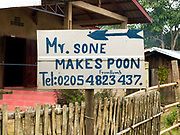 A sign to a metalworkers house who makes spoons from recycled aluminium sourced from Vietnam War debris and melted in an earthen kiln in Ban Naphia, a remote Tai Phouan village in mountainous Xieng Khouang Province in Northern Laos. Laos is the most bombed country, per capita, in the world with more than two million tons of ordnance dropped on it during the Vietnam War from 1963 to 1974.12 artisan families began transforming war scrap into spoons (150,000 per year) in the 1970s to supplement subsistence farming activities. Supported by the Swiss NGO Helvetas, the project works to make the scrap metal supply chain safer for artisans and scrap collectors by collaborating with organisations such as Mines Advisory Group (MAG) that specialise in unexploded ordnance removal and education. More recently the villagers have started making bracelets and other items.