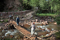 Omar ben Brahim, 62, and wife Fatima bent Ali – she guessed her age between 59 and 61 – are seen walking to their home in the village of Aid ben Brahim outside Marrakech, Morocco on May 11, 2009. Omar ben Brahim spent his life working as a mason and built the home that he and his family live in.