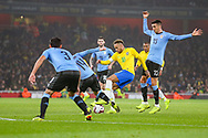 Brazil forward Neymar Jr (10) attempts to break through the Uruguay defence during the Friendly International match between Brazil and Uruguay at the Emirates Stadium, London, England on 16 November 2018.