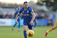 Barry Fuller (Captain) of AFC Wimbledon chases down the lose ball during the Sky Bet League 2 match between AFC Wimbledon and Mansfield Town at the Cherry Red Records Stadium, Kingston, England on 16 January 2016. Photo by Stuart Butcher.