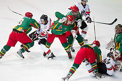 Christoph Herzog of Austria between Benas Silinskas and Lukas Manomaitis of Luthuania,  Fabio Hofer of Austria between Marius Krikstanaitis of Lithuania and goalkeeper Mantas Armalis of Lithuania  during the ice hockey match between National teams of Lithuania (LTU) and Austria (AUT) at 2011 IIHF World U20 Championship Division I - Group B, on December 12, 2010 in Ice skating Arena, Bled, Slovenia.  (Photo By Vid Ponikvar / Sportida.com)