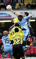Photo:  Frances Leader.<br /> Watford v Coventry City. Coca Cola Championship. <br /> Vicarage Road Stadium<br /> 05/03/2005<br /> Watford's Richard Lee punches the ball away from the goal as both teams jump for the ball.