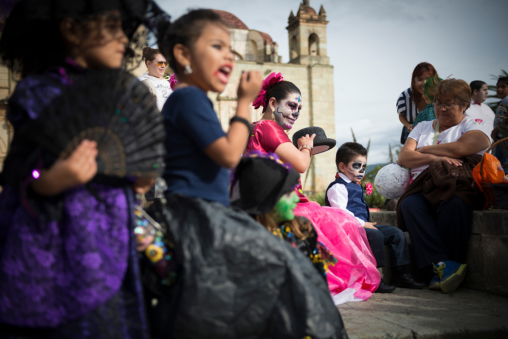 """Mexican children gather outside the Church of Santo Domingo de Guzmán in Oaxaca, Mexico, dressed up for Day of the Dead celebrations (""""Día de los Muertos"""" in Spanish)."""