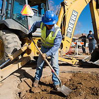 111913       Brian Leddy<br /> Robert Sekiya of the City of Gallup Water Department spreads dirt on top of a repaired water main on the corner of Second Street and Wilson Avenue Tuesday. The city has had to repair the water line multiple times.
