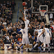 Rashad Smith, Tulsa and Rodney Purvis, UConn, challenge for a rebound during the UConn Huskies Vs Tulsa Semi Final game at the American Athletic Conference Men's College Basketball Championships 2015 at the XL Center, Hartford, Connecticut, USA. 14th March 2015. Photo Tim Clayton