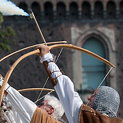 MILAN, ITALY - JUNE 05: Archers take part in a competition in front of the Castello Sforzesco during the 1st Palio Citta' di Milano  on June 5, 2010 in Milan, Italy. The Palio Citta di Milano is a re-enactment of a medieval tournament in which only women partake as commemoration of the courage displayed by local women during the Vigevano siege of 1449.  (Photo by Marco Secchi/Getty Images)