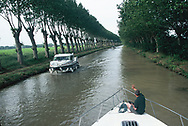 Renting a barge and traveling the Midi Canal in France.<br />Photo by Dennis Brack
