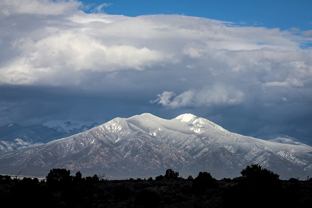 Late afternoon snowfall blankets Taos Mountains, Rift Valley Trail, Taos, New Mexico