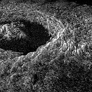 Planet Venus. three dimensional representation of brightness variations in a Magellan radar image of Golubkina crater enhances the structural features of the crater. Golubkina is 34 kilometres (20.4 miles) in diameter, and is located at about 60.5 degrees north latitude, 287.2 degrees east longitude. Golubkina is characterized by terraced inner walls and a central peak, typical of large impact craters on the Earth, Moon and Mars. The terraced inner walls form at late stages in the formation of an impact crater, due to collapse of the initial cavity formed by the meteorite impact. The central peak forms due to rebound of the inner crater floor.
