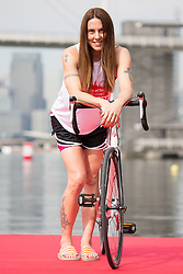 © Licensed to London News Pictures. 27/07/2013. London, UK. Melanie C poses with a bicycle at the London Triathlon 2013 at the ExCel centre in Royal Victoria Dock in East London. Photo credit : Vickie Flores/LNP