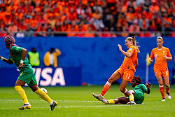 15-06-2019 FRA: Netherlands - Cameroon, Valenciennes<br /> FIFA Women's World Cup France group E match between Netherlands and Cameroon at Stade du Hainaut / Flying tackle Raissa Feudjio #8 of Cameroon, Lieke Martens #11 of the Netherlands