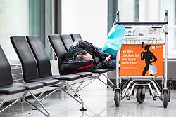 THEMENBILD - Airport Muenchen, Franz Josef Strauß (IATA: MUC, ICAO: EDDM), Der Flughafen Muenchen zählt zu den groessten Drehkreuzen Europas, rund 100 Fluggesellschaften verbinden ihn mit 230 Zielen in 70 Laendern, im Bild ein schlafender Passagier wartet auf seinen Abflug // THEME IMAGE, FEATURE - Airport Munich, Franz Josef Strauss (IATA: MUC, ICAO: EDDM), The airport Munich is one of the largest hubs in Europe, approximately 100 airlines connect it to 230 destinations in 70 countries. picture shows: a sleeping passenger waiting for his departure, Munich, Germany on 2012/05/06. EXPA Pictures © 2012, PhotoCredit: EXPA/ Juergen Feichter
