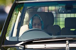 © London News Pictures. 12/05/2012. Windsor, UK. HRH Queen driving around the grounds of Windsor Castle in a Land Rover on day four of the Royal Windsor Horse Show in the grounds of Windsor Castle, Berkshire,  on May 12, 2012. Photo credit: Ben Cawthra/LNP