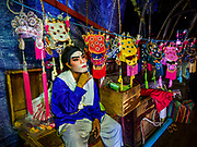 """26 FEBRUARY 2018 - BANGKOK, THAILAND: A performer backstage before a Chinese Opera at the Phek Leng Shrine in the Khlong Toey section of Bangkok. The shrine traditionally hosts a Chinese Opera just after the end of Lunar New Year festivities. Thailand is home to the largest population of overseas Chinese in the world, and Chinese cultural practices, like Chinese opera, called """"ngiew"""" in Thailand, are popular. Many of the performers are ethnic Thais who don't speak Chinese. They learn their lines phonetically.     PHOTO BY JACK KURTZ"""